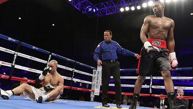 Boxer Travell Mazion, right, watches his opponent struggle to get back up during one of his fights. The Del Valle fighter was a rising talent in the state's super welterweight ranks before his death in a car crash last week.