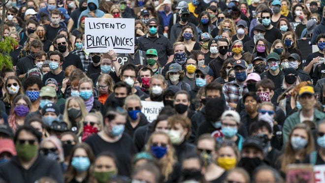 Demonstrators gather at a rally to peacefully protest and demand an end to institutional racism and police brutality, Wednesday, June 3, 2020, in Portland, Maine.