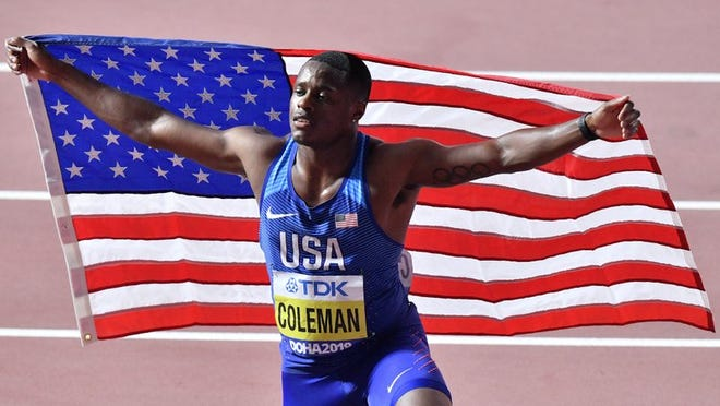 FILE - In this Sept. 28, 2019, file photo, Christian Coleman, of the United States, poses after winning the men's 100 meter race during the World Athletics Championships in Doha, Qatar. Reigning world champion Coleman insists a simple phone call from drug testers while he was out Christmas shopping could've prevented the latest misunderstanding about his whereabouts, one he fears could lead to a suspension.