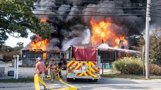 Sandwich fire crews respond to a two-alarm fire Saturday afternoon at Russo's Cape Cod Bark & Landscape on Route 130.