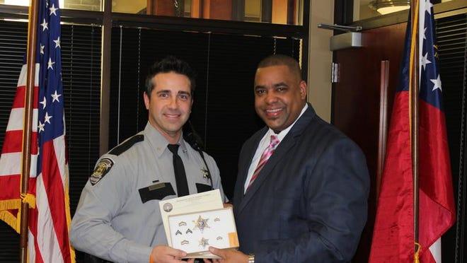 Saal, left, and Richmond County Sheriff Richard Roundtree.