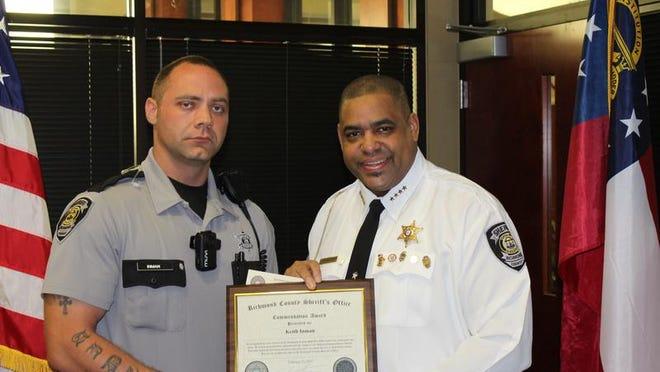 Deputy Keith Inman with Sheriff Richard Roundtree.