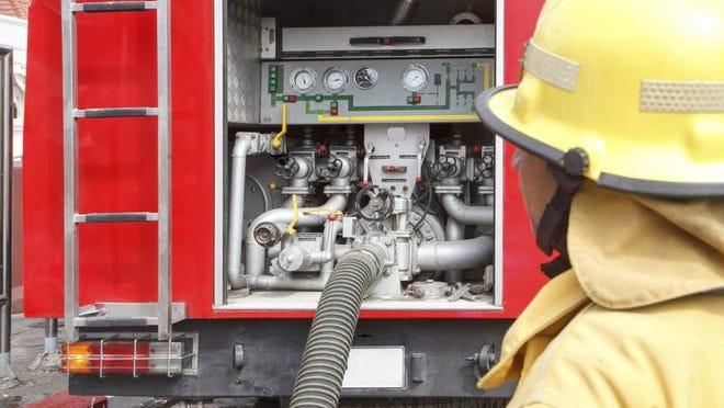 Fireman with fire truck