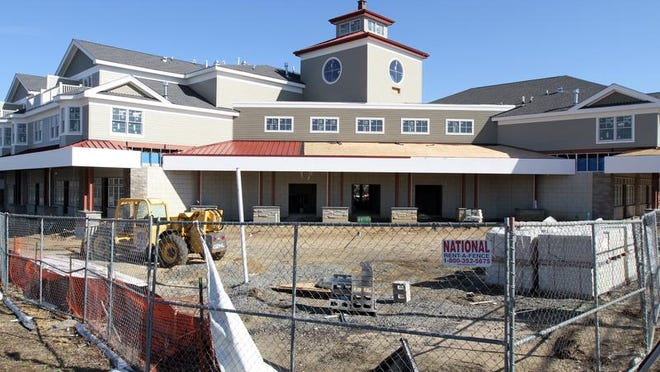 Oceanport Village Center's two buildings will mix retail stores and apartments.