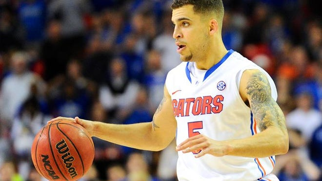 Florida Gators guard Scottie Wilbekin in action against the Kentucky Wildcats during the second half in the championship game for the SEC college basketball tournament at Georgia Dome. Florida defeated Kentucky 61-60.