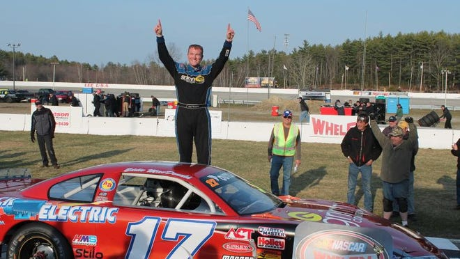 Eddie MacDonald celebrates his victory in the New Hampshire Governor's Cup 150 at Lee USA Speedway on Sunday. MacDonald, whose parents own the track, had never won an American-Canadian Tour event at his home track.