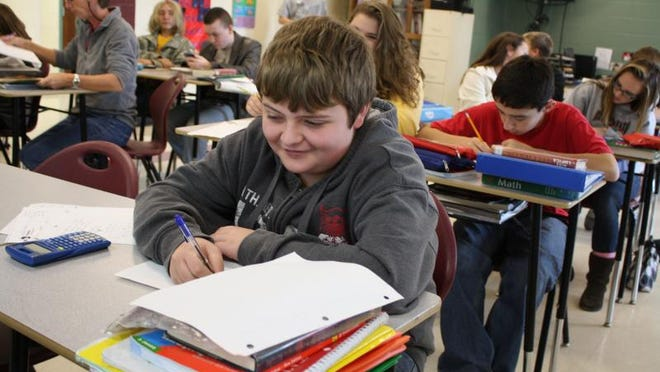 A student at the Bethel-Tate Local School District Middle School works out an example of an Ohio Achievement Assessment test question during math class. Students across Ohio will now get an extra week to take the assessments because of severe weather this winter.