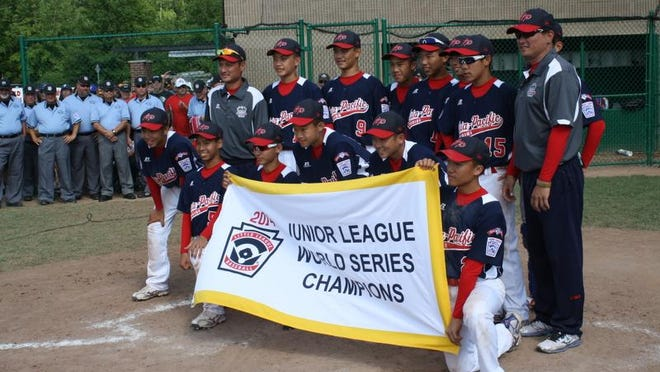 Chinese Taipei (Taiwan) celebrates its Junior League World Series championship, Saturday, Aug. 16, 2014, in Taylor.