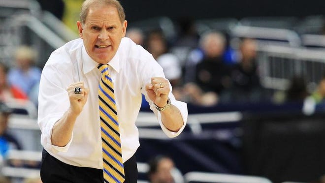 Michigan basketball coach John Beilein reacts in the second half against the Florida Gators on March 31, 2013, in Arlington, Texas.