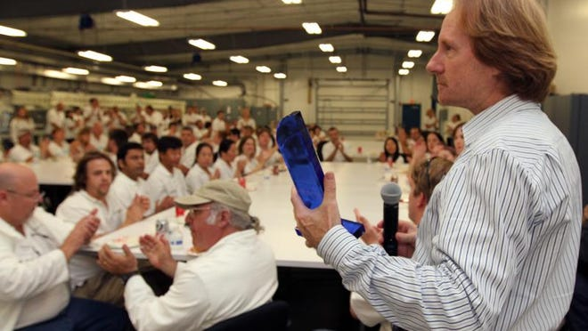 On Monday, the lunchroom at Algenol erupted with applause after CEO Paul Woods presented his staff with the 2013 Governor's Innovators in Business Award.