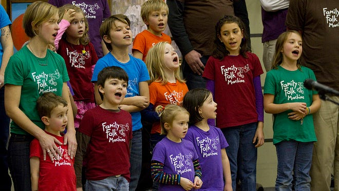Members of the Family Folk Machine perform. The choir will next perform Sunday and April 19.