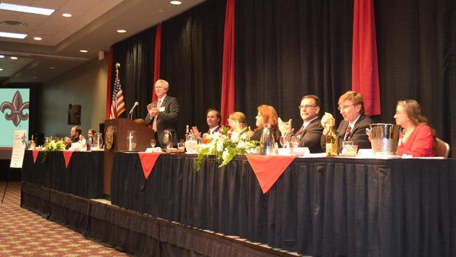University of Louisiana at Lafayette Provost and Vice President of Academic Affairs James Henderson leads administration and attendees in applause for this year's honorees at the Distinguished Professor Awards held at the Cajundome Convention Center.