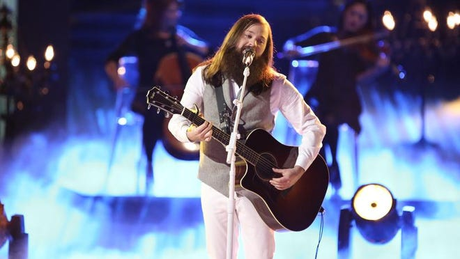 """Cole Vosbury is shown performing on the popular NBC television series """"The Voice."""""""