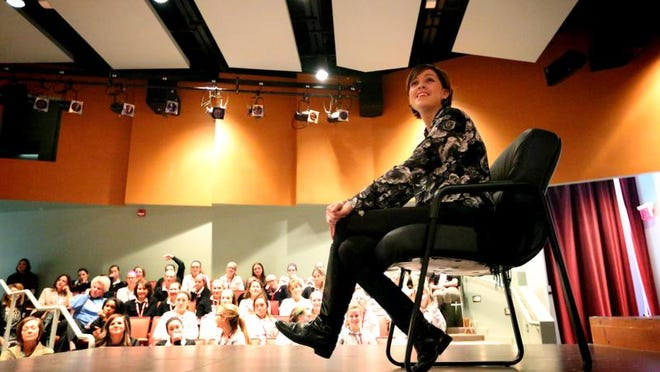 Breast cancer patient Jill Brzezinski-Conley tells students at Assumption High School on Wedneday that her mission before she dies is to share her belief that true beauty is about confidence and kindness.