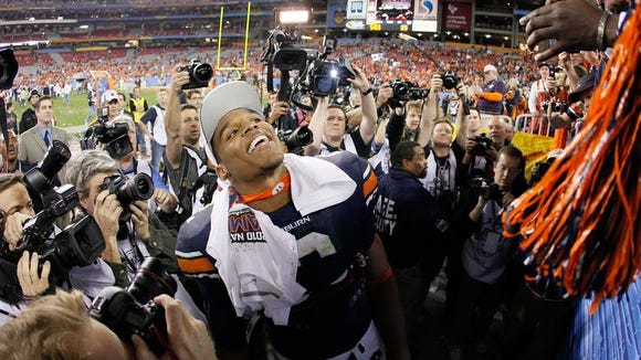 Quarterback Cam Newton celebrates Auburn's 22-19 victory over Oregon Ducks on Jan. 10, 2011, in Glendale, Arizona.