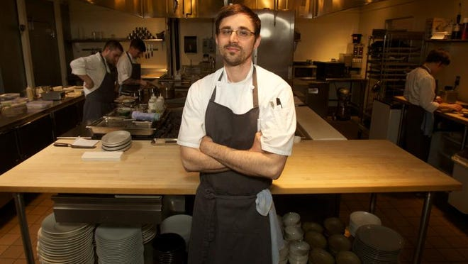 In this April 17, 2013 photo, Chef Justin Woodward stands in the kitchen of the restaurant Castagna in Portland, Ore. Far from the expectant gaze of major restaurant critics and the accompanying pressure to produce the Next Big Thing, the little-big city of Portland offers chefs a unique opportunity - the chance to experiment.