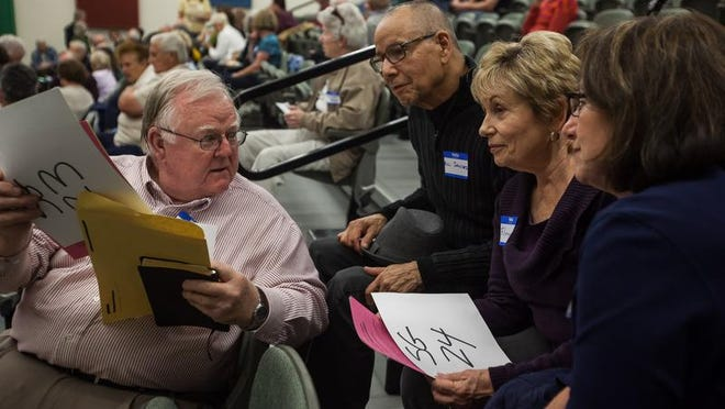Glenn Wilde, Bill Sanchez, Florence Clotfelter and Raye Ann Bennett meet during the Democratic Caucus at Tonaquint Intermediate on Tuesday, March 18, 2014. The 2016 caucuses are scheduled for March 22.