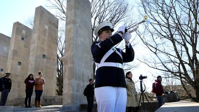 Ross Roderick, of the Virginia Tech Corps of Cadets, plays a portion of Echo Taps at the Virginia Tech War Memorial following a moment of silence honoring the victims of an April 16, 2007, mass shooting on the Virginia Tech campus in Blacksburg, Va., Wednesday, April 16, 2014. (AP Photo/The Roanoke Times, Matt Gentry)  LOCAL TV OUT; SALEM TIMES REGISTER OUT; FINCASTLE HERALD OUT;  CHRISTIANBURG NEWS MESSENGER OUT; RADFORD NEWS JOURNAL OUT; ROANOKE STAR SENTINEL OUT