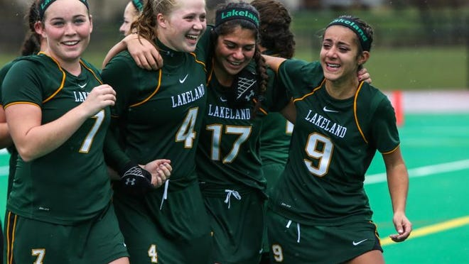 The Lakeland High School field hockey team celebrates following the 2014 Class B state championship game. It was one of nine state titles won by the Hornets during the last decade.