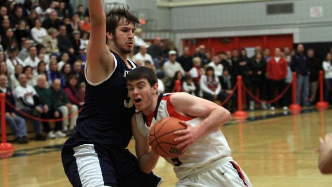 Eastchester's Jack Daly (5) tries to drive around Byram Hills' Andrew Groll (34) during a Class A quarterfinal boys basketball game at Eastchester High School Feb. 19, 2014.