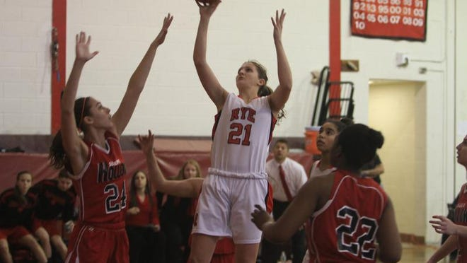 Rye's Maddie Eck (21) goes up for a shot in front of Sleepy Hollow's Grace Carr (24) during a girls basketball playoff game at Rye High School on Wednesday.