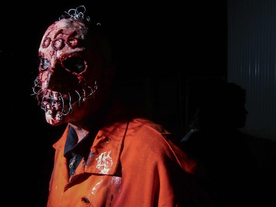 An actor waits to scare guest from hidden location at Frightland in Middletown last year.