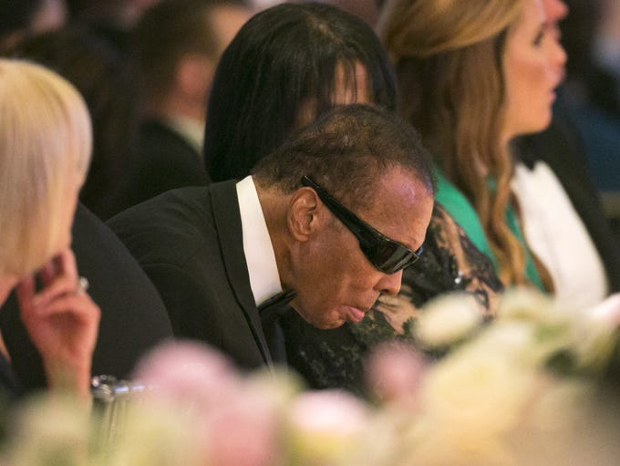 Legendary boxer Muhammad Ali sits at the dais during