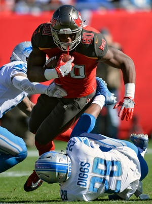 Detroit Lions cornerback Quandre Diggs trips up Tampa Bay Buccaneers tight end O.J. Howard after a catch in the first half Sunday, Dec. 10, 2017 in Tampa, Fla.