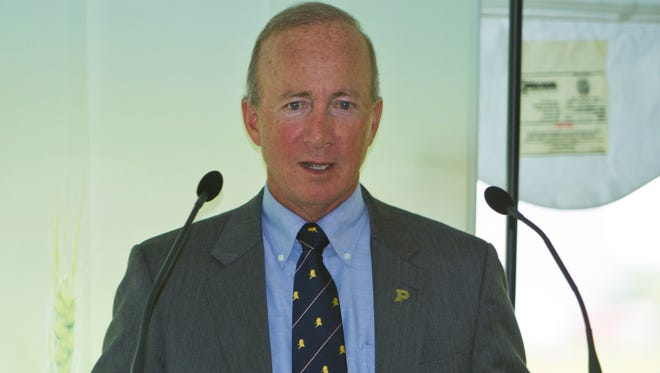 Purdue President Mitch Daniels speaks July 21, 2014, during a groundbreaking ceremony for a General Electric Aviation facility in Lafayette. The plant will build  GE's LEAP, a high-efficiency jet engine.