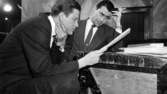 """FILE - In this Feb. 10, 1955, file photo, television writer Rod Serling, right, huddles with producer-director Fielder Cook, backstage at a New York rehearsal for a precedent-making telecast of Serling's """"Patterns,"""" on Television Theater. Years before he journeyed to """"The Twilight Zone,"""" Serling made a brief detour to the strike zone, writing a comedy about baseball. (AP Photo/Bob Wands, File)"""