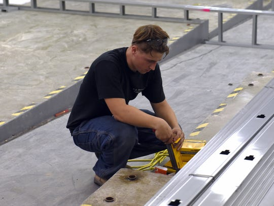 Evan Parks, of K.E. Dittmar Co., works with drive pins