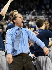 Nevada's head coach Eric Musselman cheers on his team