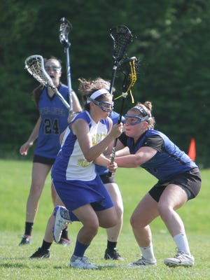 North Salem's Ryann Shaughnessy (in white) is defended by Pearl River's Maggie Davin during a Class C semifinal game at Volunteers Field. Pearl River won 14-11.
