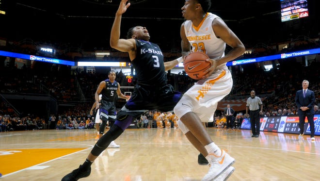 Kansas State's Kamau Stokes (3) defends against Tennessee's Jordan Bowden (23) during an NCAA SEC-Big 12 basketball game between Tennessee and Kansas State at Thompson-Boling Arena in Knoxville, Tennessee on Saturday, January 28, 2017.