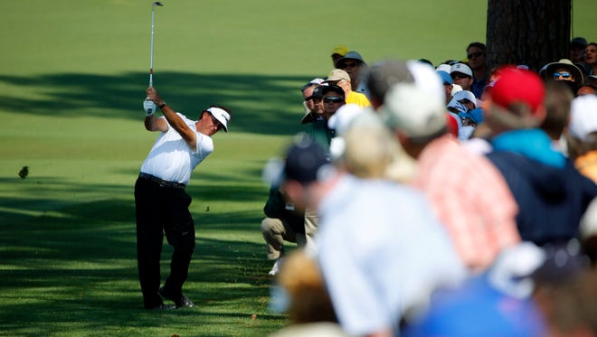 Phil Mickelson hits out of the rough on the 2nd hole during the second round of the Masters golf tournament at Augusta National Golf Club on Friday.