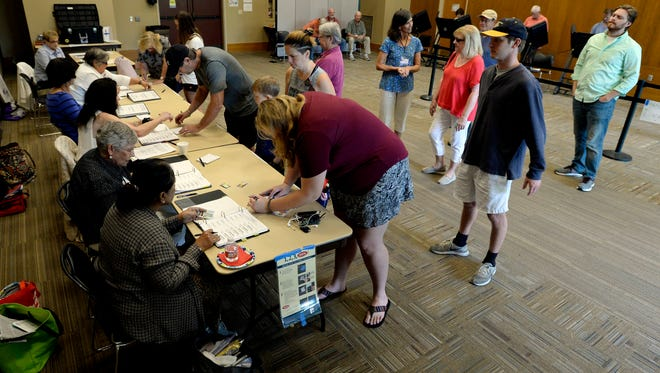 People sign in to vote at the Brentwood Library on Aug. 2.