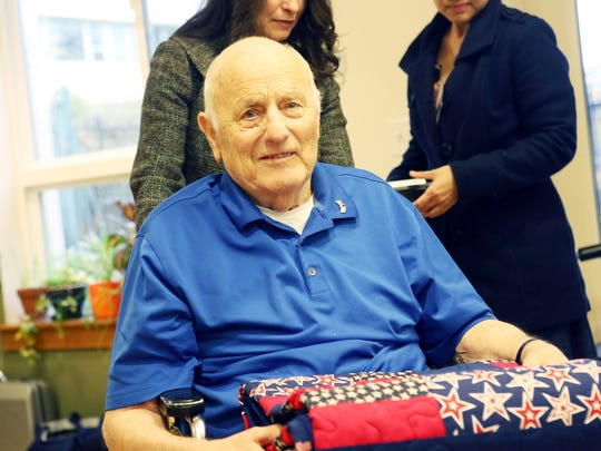 Volunteers with Willamette Valley Hospice honor patients who are veterans, including John Hays, a World War II Army veteran honored Thursday, Nov. 13, 2014, at Friendsview Retirement Community in Newberg.