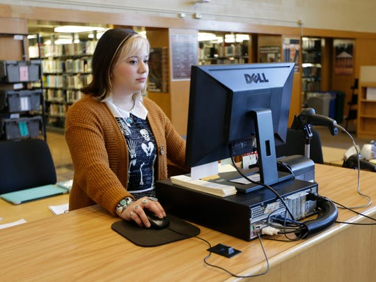 Andie Stella, an Alverno College senior, is a student desk worker in the college's library. She plans to graduate from the Milwaukee college next fall to pursue what she has decided is her true passion — library sciences and information studies.
