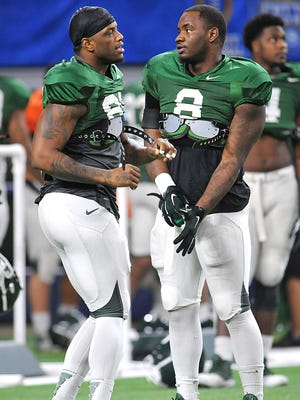 Shilique Calhoun, left, and Lawrence Thomas take time out from Cotton Bowl practice for a little dancing.
