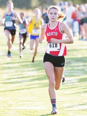 North Fort Myers High School's Kayla Easterly races to the finish line in the Estero DDD Invitational at Estero Community Park on Saturday. Thirty-seven high school teams from throughout South Florida competed in the annual event.