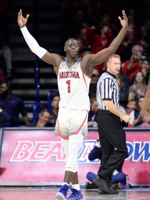 Arizona Wildcats guard Rawle Alkins (1) celebrates after scoring against the Connecticut Huskies during the second half at McKale Center.