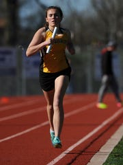 Watkins Memorial's Jamey Spindler competes in the 6,400 relay this past Friday during the Fulton Relays at Lancaster.