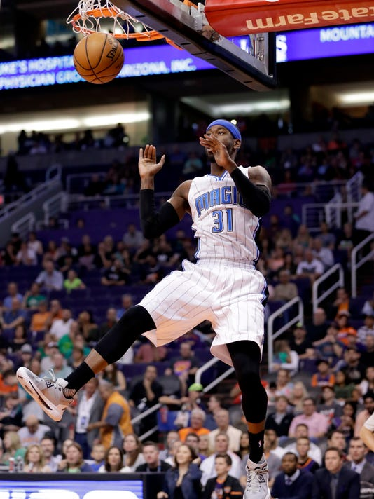 Orlando Magic forward Terrence Ross (31) dunks against the Phoenix Suns during the first half of an NBA basketball game, Friday, March 17, 2017, in Phoenix. (AP Photo/Matt York)