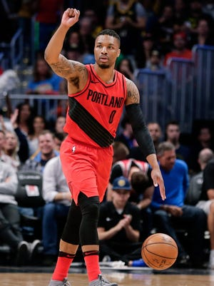Damian Lillard handed out free shoes and signed autographs during a meet-up in Portland on Monday night.