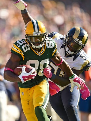 Green Bay Packers wide receiver Ty Montgomery (88) runs after a catch against St. Louis Rams outside linebacker Akeem Ayers (56) at Lambeau Field October 11, 2015.