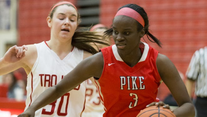 Brittany Ward of Pike High School, sheds defender Regan Wentland of Center Grove High School, during the Pike defeat of Center Grove High School, girls basketball from Center Grove, Greenwood, Saturday, Dec. 20, 2014.