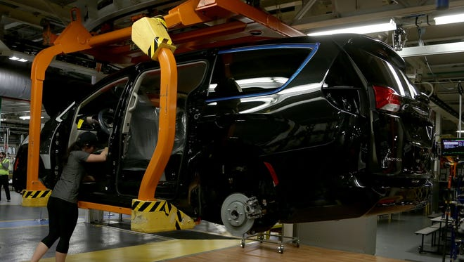 A 2017 Chrysler Pacifica in the middle of being worked on in what is called the skillet line at the FCA Windsor Assembly Plant in Windsor, Ontario Canada on Friday, May 6, 2016.Eric Seals/Detroit Free Press