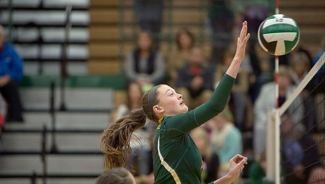 Delaney McCullough taps the ball over to the North Henderson Knights Tuesday October 27, 2015 during the Rockets' home game.