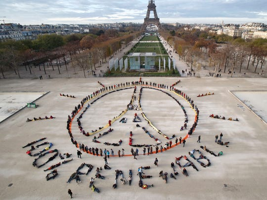 Environmentalist activists form the peace sign and