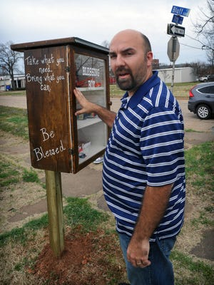 Jeremy Aaron, domestic missionary director for the Corner Community Outreach Center, describes the types of essentials needed to stock the Blessing Box at the corner of Bluff and 11th streets.